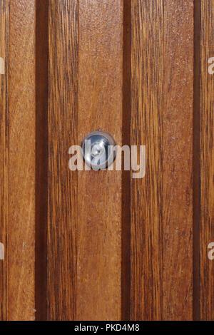 Security door viewer spy hole in old bank door - Stock Photo