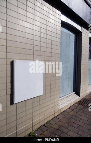 Bank closure signs in ex bank window at a Nat West Bank Closed in Dinnington, South Yorkshire - Stock Photo