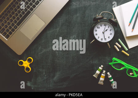 Back to school, top view flat lay concept with various educational accessories on blackboard - Stock Photo
