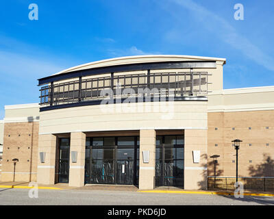 Front exterior of an empty store or store front or a closed retail shop in a shopping center in Montgomery Alabama, USA. - Stock Photo