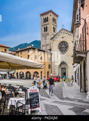 view of the Romanesque Basilica of San Fedele with its prominent Rose Window, seen from Piazza San Fedele in Como, Lomardy, Italy - Stock Photo