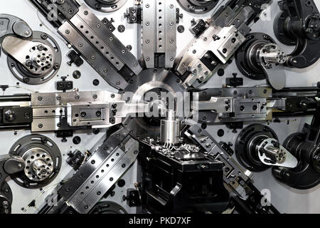 High precision automotive and industrial spring making machine in industry factory. Smart industry factory concept. - Stock Photo