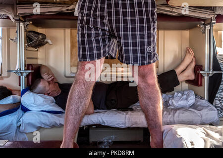 SIBERIA, RUSSIA - MARCH 20, 2018: Daily life in Trans Siberian Express. A passenger is trying to sleep - Stock Photo