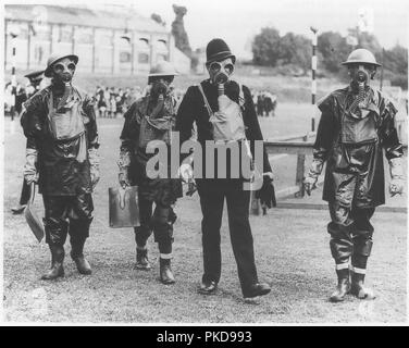 A British policeman and soldiers of the Queen's Own Royal West Kent Regiment British army demonstrating gas masks and anti gas clothing July 31st 1936 - Stock Photo