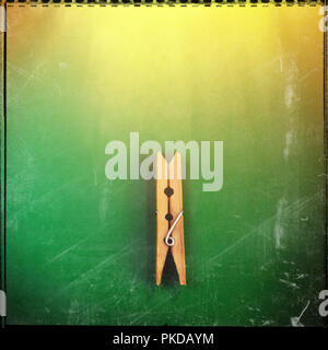 wooden clothespin on a green background. Element of design. Web banner. - Stock Photo