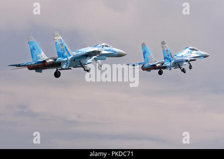 Two Ukrainian Air Force Sukhoi SU-27 air superiority jet fighters depart RAF Fairford after attending the Royal International Air Tattoo - Stock Photo