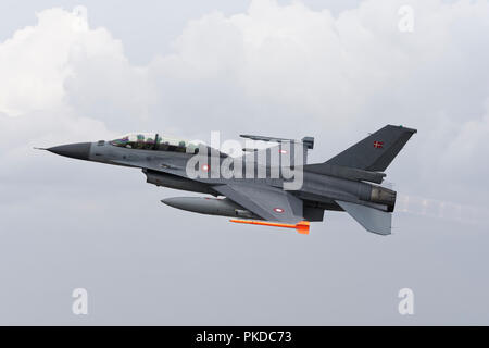 A two seat Lockheed Martin F-16 Fighter Jet from the Danish Air Force departs RAF Fairford after attending the Royal International Air Tattoo - Stock Photo