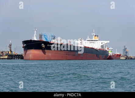 Bulk Crude Oil Tanker Elandra Falcon berthed at Fawley Refinery in Southampton Water in the Southern United Kingdom - Stock Photo