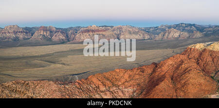 Early light shines on the massive geologic formations in Red Rock Canyon National Conservation Area, located just outside of Las Vegas, NV. - Stock Photo