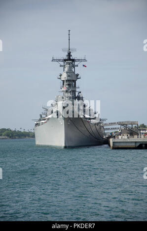 The USS Missouri (the ship on which the hostilities with Japan in WWII were officially ended) anchored in Pearl Harbor, Hawaii. December 2010. - Stock Photo