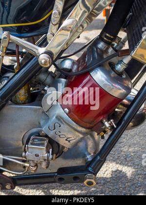 Close up of the engine of a 1928 Scott Works TT racer showing water cooling radiator and the Pilgrim oil pump total loss lubrication system - Stock Photo