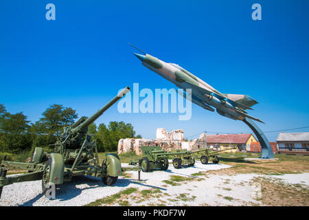 Karlovac, Croatia, old cannon and Russian fighter jet in military open air museum in Turanj, Karlovac, Croatia - Stock Photo