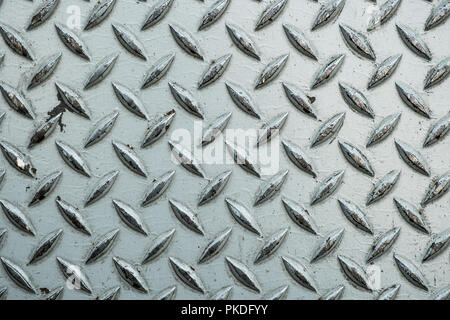Close up of used rough steel sheet with diamond plate pattern/metallic texture background - Stock Photo