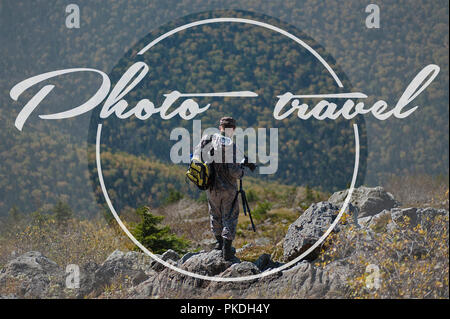 photographer at the top of the mountain photo journey in the mountains poster - Stock Photo