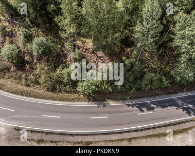 Aerial view of a lonely asphalted country road in the Harz Mountains - Stock Photo