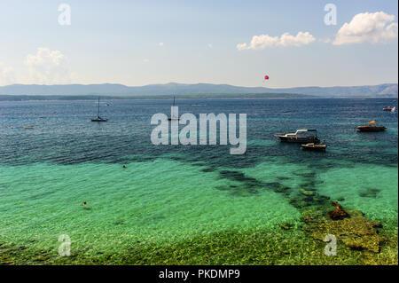 turquoise sea water off the coast of the island of Brac - Stock Photo