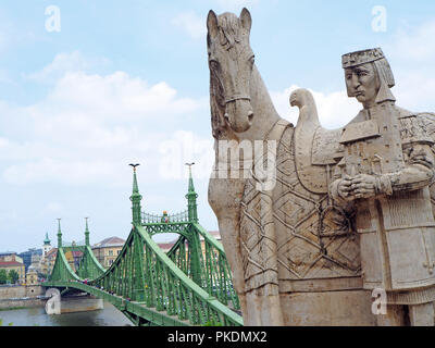 the statue of st stephen with the liberty bridge in budapest - Stock Photo
