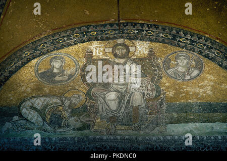 Turkey. Istambul. Hagia Sofia. Byzantine mosaic. Emperor Leon VI praying homage to Christ as Pantocrator, with medallions of Virgin Mary and Archangel Gabriel. Narthex mosaic. 10th century. - Stock Photo