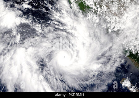 Hurricane on Earth viewed from space. Typhoon over planet Earth. Elements of this image are furnished by NASA. - Stock Photo