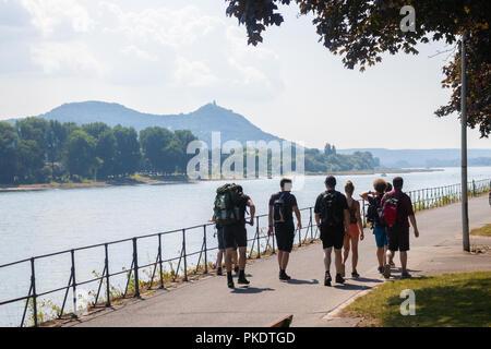 A group of walkers walking along the Rhine near Bonn Germany. - Stock Photo