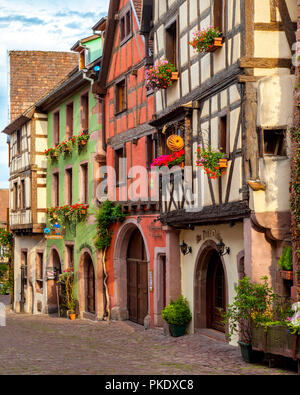 Half-Timbered buildings on Rue du General de Gaulle in Riquewihr - along the Wine Route, Alsace Haut-Rhin France - Stock Photo