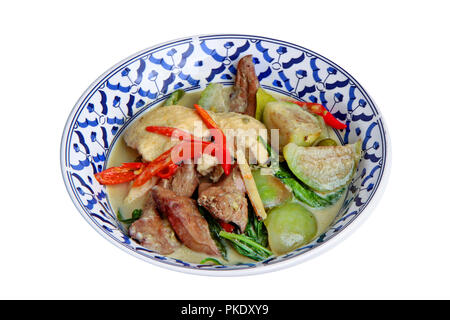 Thai popular recipe, Green chicken curry in coconut milk with eggplant and boiled chicken blood. - Stock Photo
