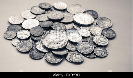 silver coins of different countries and times - Stock Photo