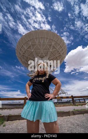 Beautiful woman poses to show scale of the Very Large Array located in New Mexico - Stock Photo