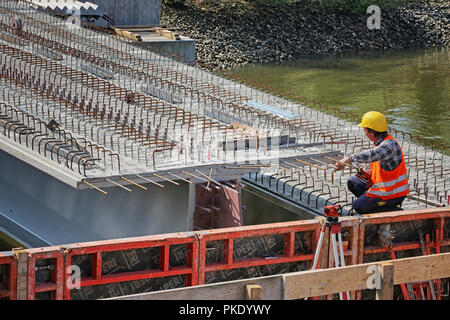 assembly of a carrier element for the new rethe bridge in the port of Hamburg - Stock Photo