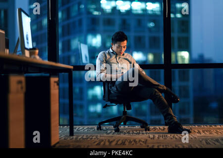 Business men in the office to work overtime - Stock Photo