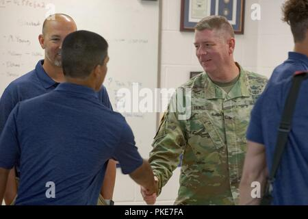 Brig. Gen. Marvin T. Hunt shakes hands with U.S.A. Baseball 14 and Under National Team Development Program (NTDP) athletes during their visit to the 449th Theater Aviation Brigade's Headquarters in Morrisville, North Carolina on July 26, 2018. The Athletes, which play their third and final game of the series on Friday July 27th, also learned about teamwork and selfless sacrifice from NCNG leaders. - Stock Photo