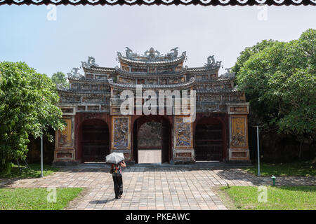 Gateway to the Thế Tổ Miếu temple group in the south-west corner of the Imperial City, Hue, Viet Nam.  MODEL RELEASED - Stock Photo