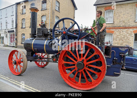 Close up detail of a vintage steam traction engine built in the UK by Clayton and Shuttleworth of Lincoln driving in a town street - Stock Photo