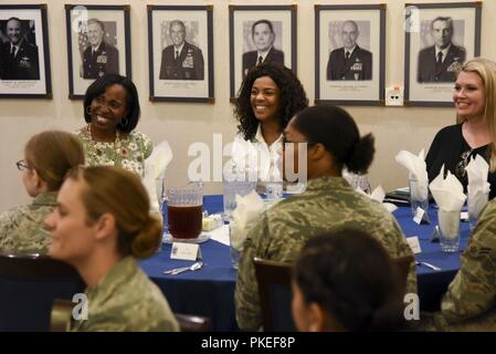 """Tonya Wright, spouse to Chief Master Sgt. of the Air Force Kaleth O. Wright, listens during a """"Let's Connect"""" meeting at the Officers Club on Ramstein Air Base, Germany, July 26, 2018. Mrs. Wright met with the """"Let's Connect"""" members prior to an enlisted all-call her husband gave. - Stock Photo"""