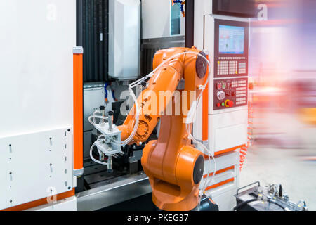 robotic arm machine tool at industrial manufacture plant,Smart factory industry 4.0 concept. - Stock Photo