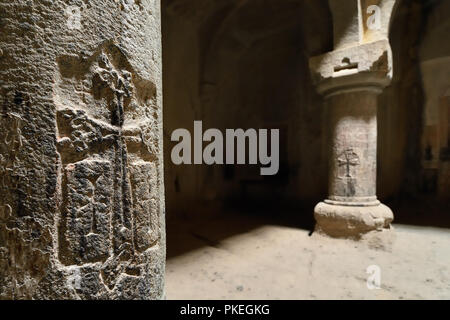 GARNI, ARMENIA - 24 AUGUST 2018: Geghard monastery near Yerevan  is a medieval monastery in the Kotayk province of Armenia, being partially carved out - Stock Photo