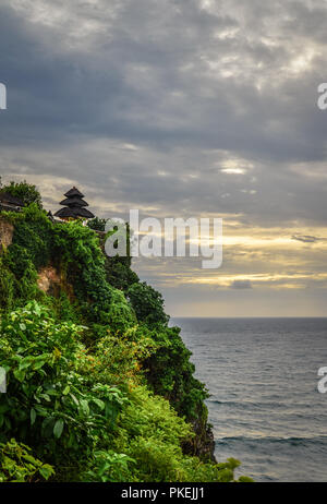 Pura Luhur Uluwatu temple, Bali, Indonesia. Amazing landscape - cliff with blue sky and sea - Stock Photo