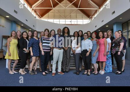 Tonya Wright, center, spouse of Chief Master Sgt. of the Air Force Kaleth O. Wright, poses for a photograph with Team Mildenhall key spouses at RAF Mildenhall, England, Aug. 2, 2018. During her visit, Mrs. Wright heard concerns and answered questions about U.S. Air Force family support programs. - Stock Photo