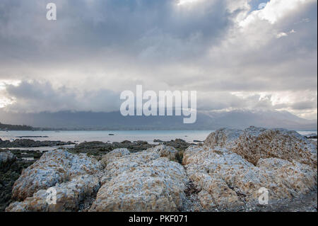 Kaikoura landscape, Canterbury, New Zealand: Beautiful coastline,  rocky foreground, view to distant mountains. - Stock Photo
