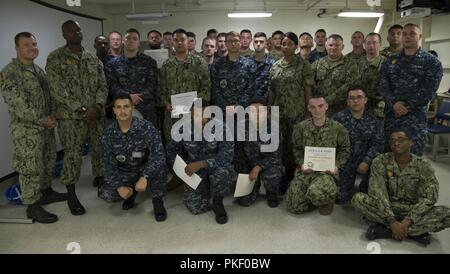 NEWPORT NEWS, Va. (Aug. 3, 2018) Sailors assigned to USS Gerald R. Ford (CVN 78) pose for a group photo after graduating from an in-port security force (ISF) class. - Stock Photo