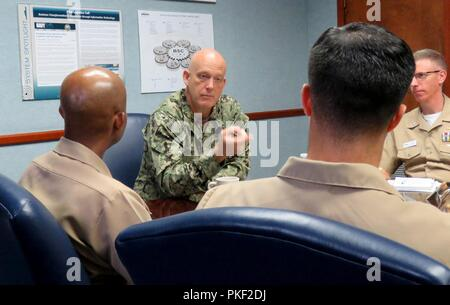 """Pa.  (Aug. 3, 2018)  Rear Adm. Kevin M. Jones, commander, Defense Logistics Agency Distribution, speaks to Naval Supply Systems Command (NAVSUP) Business Systems Center (BSC) officers during a mentoring session at NAVSUP BSC in Mechanicsburg, Pa., Aug. 3. The session was part of a series, """"Mentoring without End,"""" which brings together senior and junior Supply Corps officers in the Mechanicsburg area to share experiences, network, and collaborate. - Stock Photo"""