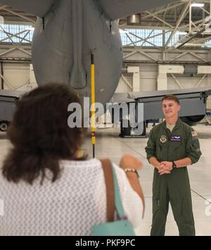 Staff Sgt. Owen Derksen, 349th Air Refueling Squadron boom operator, speaks to leaders and historic preservation staff from five Native American tribes Aug. 7, 2018, at McConnell Air Force Base, Kansas. The tribal representatives visited McConnell to communicate their interests to base leadership, they then attended a mission brief, base tour and a community visit to the local Mid-America All-Indian Center. - Stock Photo