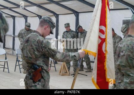 U.S. Army Maj. Jon Pirtle, chaplain for HHC 201st Regional Support Group (RSG), delivers the benediction for the Transfer of Authority Ceremony with the 139th RSG at Al Asad Air Base, Iraq, Aug. 10, 2018. This ceremony signified the final step in the process for HHC 201st RSG to assume responsibility and authority as a Base Operating Support Integrator in support of Combined Joint Task Force – Operation Inherent Resolve. - Stock Photo