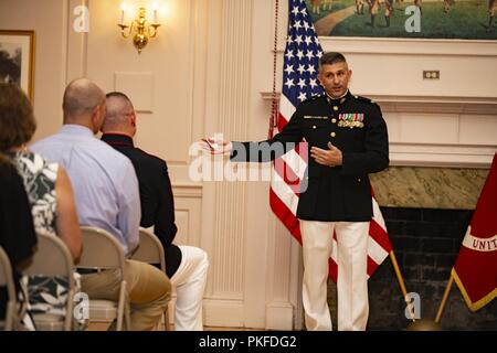 Retired U.S. Marine Corps Lt. Col. Matthew Howes speaks at the retirement ceremony of Master Gunnery Sgt. Bryan Boyd, senior enlisted advisor, Installations and Logistics, Marine Corps Base Quantico, Va, July 26, 2018. Boyd retired after 30 years of faithful service. - Stock Photo