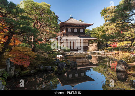 Kyoto, Japan. Ginkaku-ji zen temple, also known as the Silver Pavilion, reflected in the pond in autumn - Stock Photo