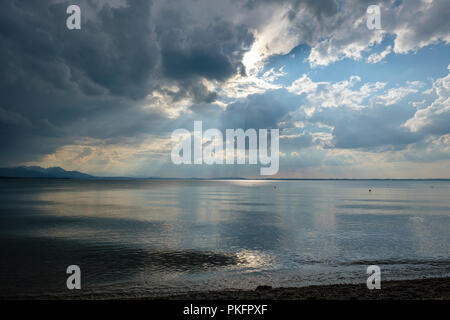 Storm clouds, dark clouds over the lake, Chieming am Chiemsee, with Chiemgau Alps, Bavaria, Germany - Stock Photo
