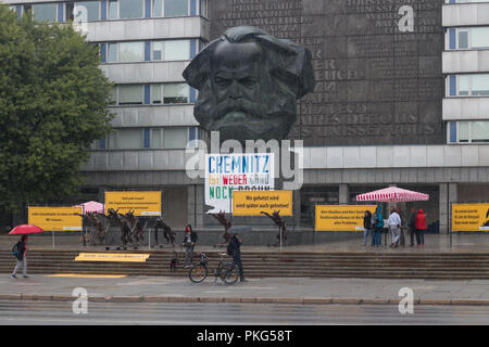 Chemnitz, Germany - September 13, 2018: View of an art installation of brass wolves giving salute Heil Hitler, the greeting of the National Socialists. The installation by the artist Rainer Opolka is intended to counteract a sign against hatred and violence after the large right-wing demonstrations a good two weeks after the murder of a German in Chemnitz by refugees. Credit: Mattis Kaminer/Alamy Live News - Stock Photo