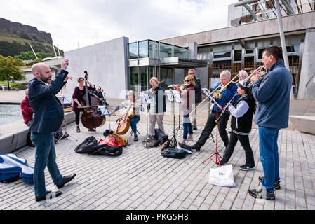 Edinburgh, UK. 13 September 2018. Campaigners take part in a pop-up orchestra outside the Scottish Parliament in Edinburgh. The protest was organised to support a petition presented to Scottish Parliament on 13 September 2018 asking for free instrumental music services to become statutory in law. Credit: Andy Catlin/Alamy Live News - Stock Photo