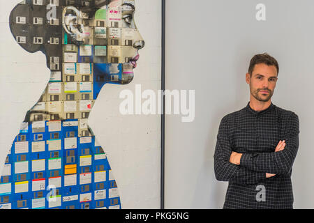 London, UK. 13th September 2018. Nick Gentry with Profile Number 16, 2018 - Human Connection, a new joint exhibition at Opera Gallery featuring work by artists Nick Gentry (UK) and Seo Young-Deok (South Korea). Both artists create figurative works from found objects; Nick paints portraits on top of obsolete technological materials such as VHS cassettes and floppy disks that contain people's memories, while Seo renders large-scale hyper-realistic sculptures of the human body from bicycle chains. Credit: Guy Bell/Alamy Live News - Stock Photo