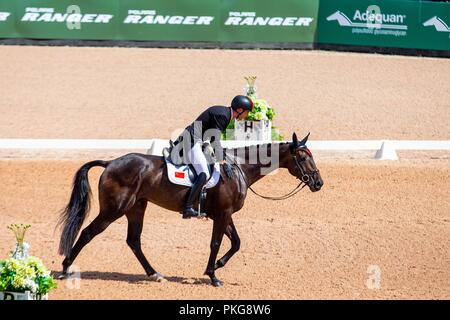 Tryon, North Carolina, USA. 13th Sep 2018. Alex Hua Tian riding Ballytiglea Vivendi. CHN. Eventing Dressage. Day 3. World Equestrian Games. WEG 2018 Tryon. North Carolina. USA. 13/09/2018. Credit: Sport In Pictures/Alamy Live News - Stock Photo